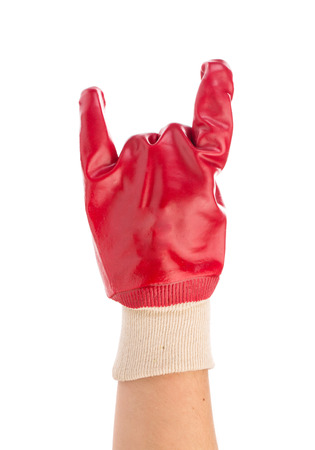 sternly: Hand in rubber glove shows rock sign. Isolated on a white background.