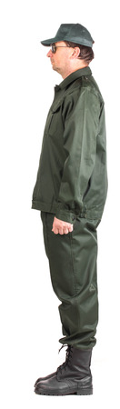 uniform green shoe: Confident man in uniform. Side view. Isolated on a white background.