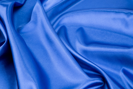 sensuous: Blue silk drapery. Isolated as a whole background.