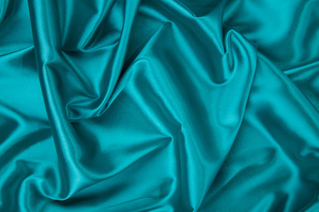 blue silk: Close up of blue silk. Whole background.