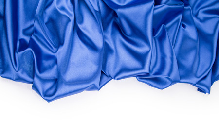 Blue silk drapery. Close up on the white background. Stock Photo