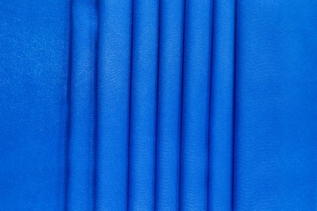 satiny: Blue silk background. Texture close up on whole background.