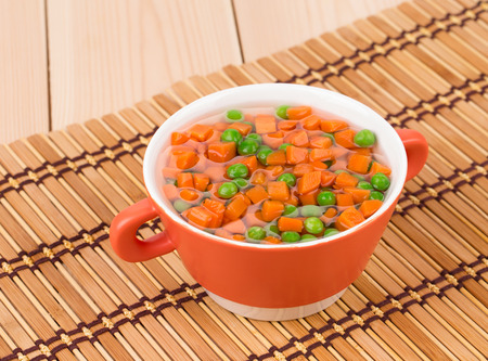 andalusian cuisine: Carrot salad on a wooden background in the closeup Stock Photo