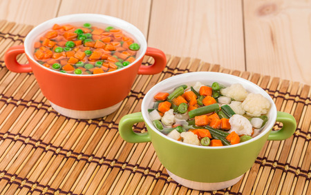 sued: Composition of fresh homemade vegetable soups. Whole background. Stock Photo