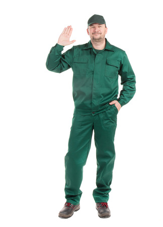 overalls: Worker in green overalls. Isolated on a white background. Stock Photo