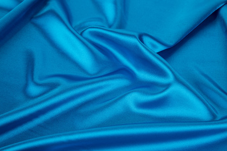 drapery: Blue silk drapery. Isolated as a whole background.