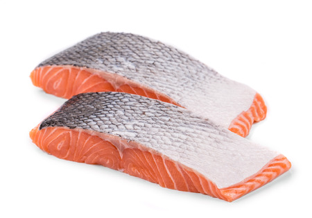 a portion: Fresh uncooked red fish fillet slices. Isolated on a white background. Stock Photo