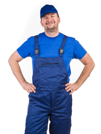 hands on waist: Worker with hands on waist. Isolated on a white background.