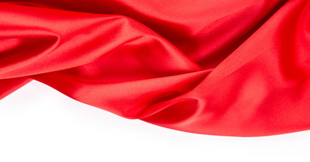 sensuous: Red silk drapery. Isolated as a whole background.