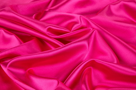 sensuous: Pink silk drapery. Isolated as a whole background.