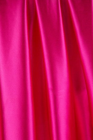 drapery: Pink silk drapery. Isolated as a whole background.