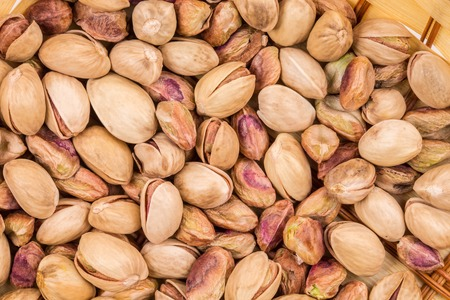 munch: Close up of fresh pistachios. Whole background.