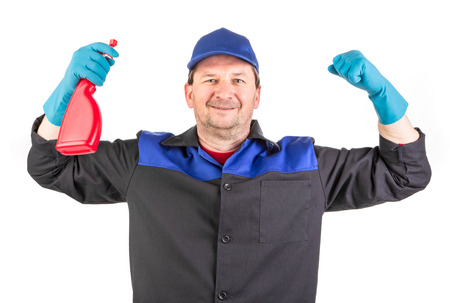 scrub cap: Worker holding spray bottle. Isolated on a white background.