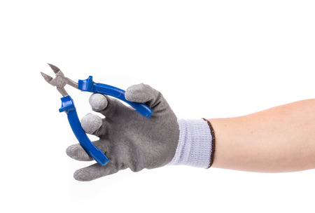 flatnose: Hand in gloves holding pliers. Isolated on a white background. Stock Photo