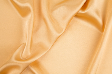 sexual abstract: Yellow silk texture cloth. Close up on the whole background.