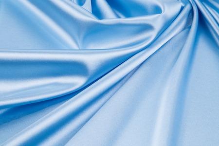 Light blue silk texture cloth. Whole background.
