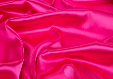 texture cloth: Pink silk texture cloth. Close up on the whole background.