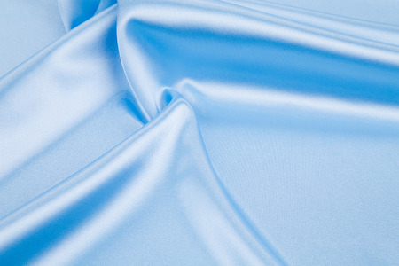 texture cloth: Blue light silk texture cloth. Close up. Whole background.
