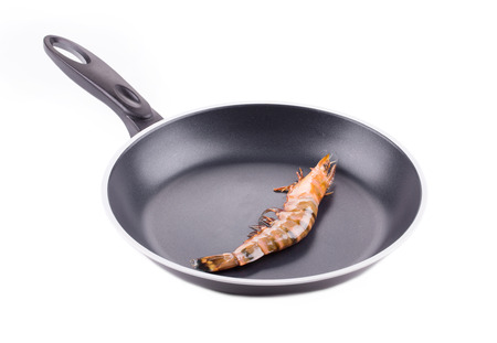 tiger shrimp: Raw tiger shrimp on frying pan. Isolated on a white background. Stock Photo