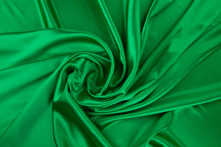 texture cloth: Green silk texture cloth. Close up on the whole background.