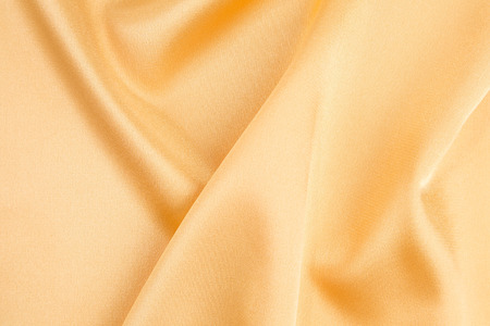 cloth texture: Close up of yellow silk cloth texture. Whole background.