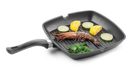 tiger shrimp: Tiger shrimp on black pan. Isolated on a white background.