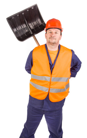scour: Worker holding black shovel. Isolated on a white background.
