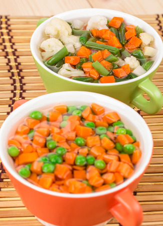 sued: Fresh homemade vegetable soups. Close up on the whole background. Stock Photo