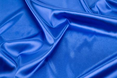 tela seda: Textura azul de la tela de seda de cerca. Todo el fondo.