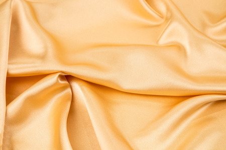 Golden silk drapery Stock Photo