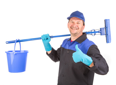 Man holding broom and bucket. Isolated on a white background. Stock Photo
