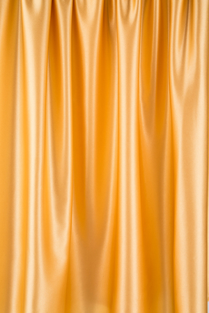 drapery: Golden silk drapery Stock Photo