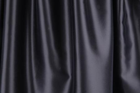 satiny: Black silk drapery