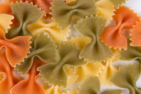 enriched: Heap of farfalle pasta. Close up