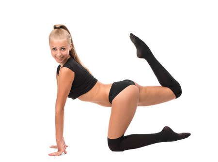 leggings: Female Gymnast isolated on a white background. Stock Photo