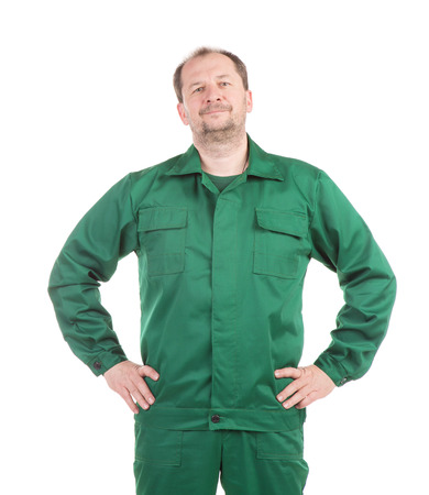 uniform green shoe: Worker with hands on waist. Isolated on a white background.