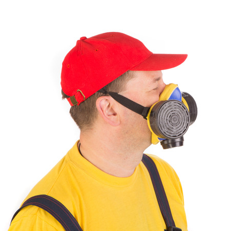 respirator: Worker in hat with respirator. Isolated on a white background.