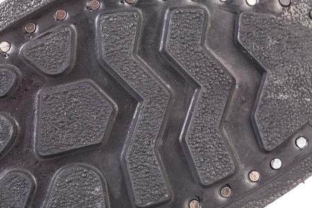sole: Black shoe sole close up. Whole background.