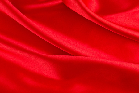 satiny cloth: Red silk drapery. Isolated as a whole background.
