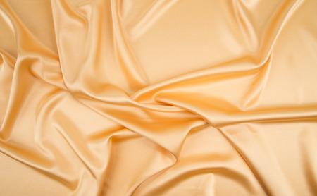 tela seda: Cierre de oro de la textura de tela de seda. Todo el fondo.