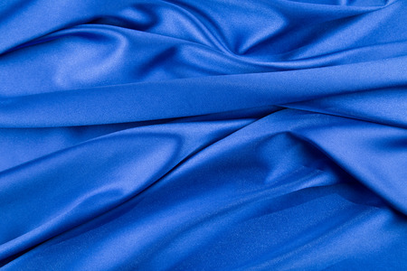 satiny cloth: Blue silk drapery. Isolated as a whole background.