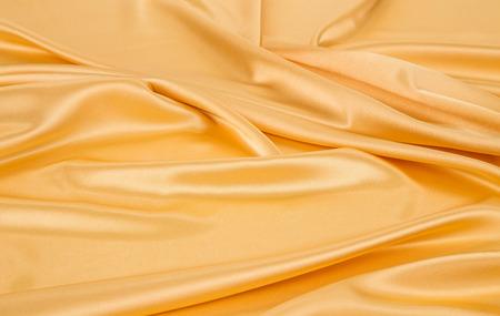 satiny: Golden silk drapery Stock Photo