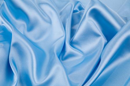 cloth texture: Soft folds of blue silk cloth texture