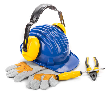 ear muff: Safety helmet, ear muff, screw driver, pliers and gloves. Isolated on a white background.