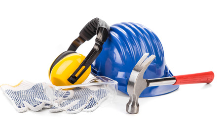 headgear: Safety helmet, hammer, headgear and gloves. Isolated on a white background.