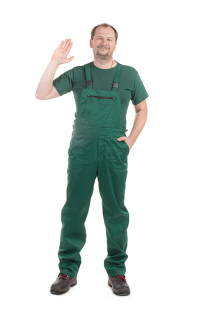 uniform green shoe: Worker in green overalls with ok sign. Isolated on a white background.