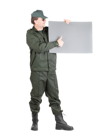 uniform green shoe: Man in workwear stands with paper. Isolated on a white background.
