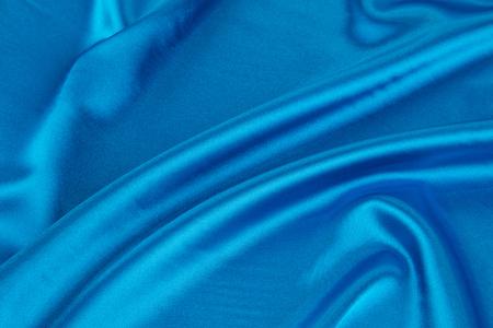 blue silk: Soft folds of blue silk cloth texture