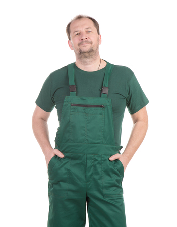 uniform green shoe: Worker in green overalls. Isolated on a white background. Stock Photo