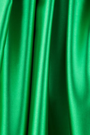sensuous: Green silk drapery. Isolated as a whole background.